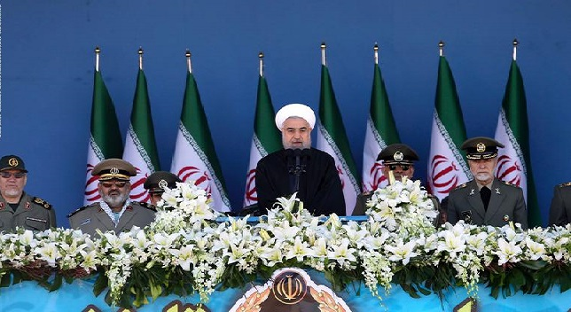 Iranian President Hassan Rouhani (C) delivers a speech during the Army Day parade in Tehran on April 17, 2015. / AFP / CHAVOSH HOMAVANDI        (Photo credit should read CHAVOSH HOMAVANDI/AFP/Getty Images)