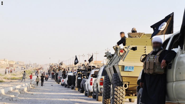 A twitter account widely believed to belong to ISIS posted this and other photos on Tuesday, June 24, 2014 showing their military parading victoriously through Mosul, Iraq.  ISIS, or The Islamic State in Iraq and Syria, is a Sunni Muslim extremist group formerly linked to al-Qaeda.  Mosul and many other Iraqi towns have fallen under their control as the Iraqi military has largely proved ineffectual at countering their invasion, refusing in many instances to put up a fight.