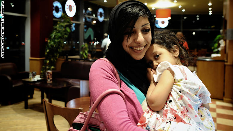 Bahraini opposition activist Zainab al-Khawaja, daughter of prominent jailed opponent Abdulhadi al-Khawaja, holds her daughter Jude as they sit in a coffee shop in the village of Abu Saiba, West of Manama, on May 29, 2012. Zainab has been released on bail one month after she was arrested and she still faces charges related to organising rallies in Bahrain. AFP PHOTO/MOHAMMED AL-SHAIKH (Photo credit should read MOHAMMED AL-SHAIKH/AFP/GettyImages)