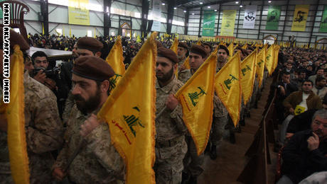 Hezbollah militants make their way into a huge hall as thousands of mainly Shiite Muslims gather to watch a televised speech by Hassan Nasrallah, the leader of the Shiite Muslim Lebanese Hezbollah militant group on February 22, 2008, in Beirut's southern suburb ten days after the assassination of top Hezbollah commander Imad Mughnieh in a bomb attack in Damascus. Nasrallah's televised speech marked the killing of Mughnieh and the 1992 assassination of its former leader Abbas Mussawi in an Israeli helicopter strike and assassinated Sheikh Ragheb Harb in 1984. AFP PHOTO / MAZEN AKL (Photo credit should read MAZEN AKL/AFP/Getty Images)