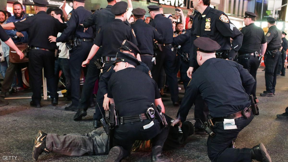 A demonstrator is arrested by NYPD officers during a protest march through Times Square April 29, 2015 in New York, held in solidarity with demonstrators in Baltimore, Maryland demanding justice for an African-American man who died of severe spinal injuries sustained in police custody. AFP PHOTO/Eduardo Munoz Alvarez (Photo credit should read EDUARDO MUNOZ ALVAREZ/AFP/Getty Images)