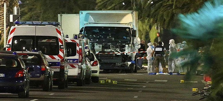 French police forces and forensic officers stand next to a truck July 15, 2016 that ran into a crowd celebrating the Bastille Day national holiday on the Promenade des Anglais killing at least 60 people in Nice, France, July 14. REUTERS/Eric Gaillard