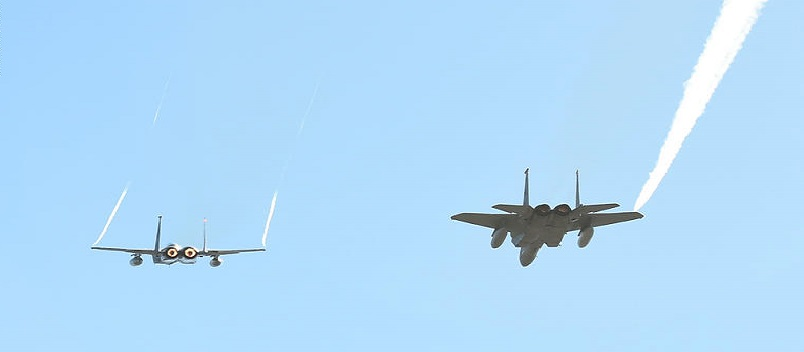 LAS VEGAS, NV - DECEMBER 19:  A pair of F-15C fighter jets from Nellis Air Force Base perform a flyover before the Brigham Young Cougars and Utah Utes play in the Royal Purple Las Vegas Bowl at Sam Boyd Stadium on December 19, 2015 in Las Vegas, Nevada. Utah won 35-28.  (Photo by Ethan Miller/Getty Images)