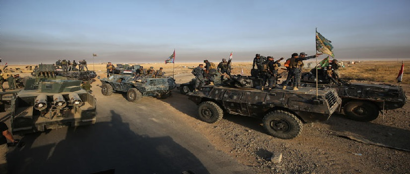 TOPSHOT - Iraqi forces deploy in the area of al-Shourah, some 45 kms south of Mosul, as they advance towards the city to retake it from the Islamic State (IS) group jihadists, on October 17, 2016. Iraqi Prime Minister Haider al-Abadi announced earlier in the day that the long-awaited operation to recapture Mosul was under way. / AFP / AHMAD AL-RUBAYE (Photo credit should read AHMAD AL-RUBAYE/AFP/Getty Images)